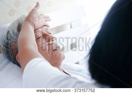Elderly Men With Lung Disease And Respiratory Diseases In Bed In The Bedroom There Is A Wife To Take