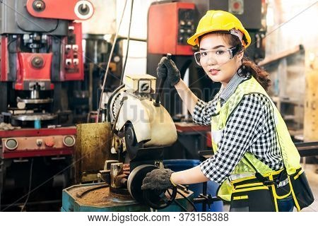 Techincians Or Engineers Asian Women  Are Working Using Steel Cutting Machines, Which Are Machines U