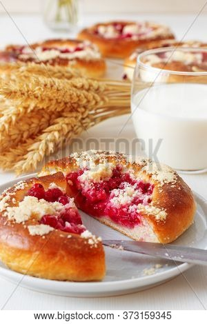 White Table With Yeasty Sweet Pastry With Fresh Currants And Raspberries And Streusel Topping, Glass