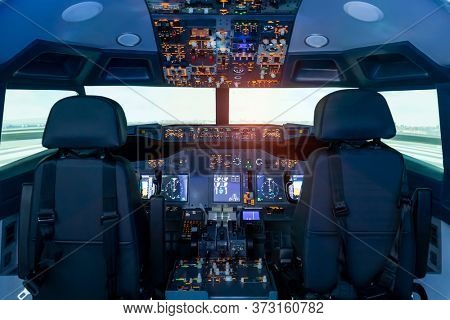 Cockpit view of a commercial jaircraft cruising Control panel in a plane