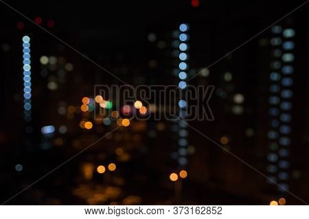 Abstract Unfocused Picture Of Night City Light Colorful Bokeh From Lamps And Lanterns, Multi-colored