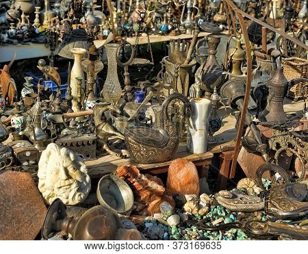 Turkey, Cappadocia, 14,07,2014 Ancient Copper Figurines, Vases And Natural Stones On The Flea Market