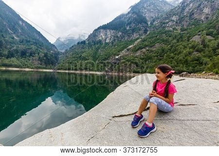 Alpine High Mountain Lake, Coniferous Woods Are Reflected In The Water, Antrona Valley Campliccioli