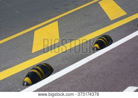 Photo Of Several Road Sings With Yellow Colour, Ground And Sunlight.
