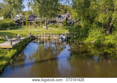 Beautiful Natural Lake Coast Landscape View. Quite Backwater With Boat Mooring And Place For Relaxin