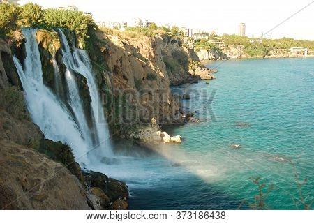 Waterfall Duden Falling Into The Mediterranean Sea With Rainbow Summer Scene In Antalya, Turkey. Wat