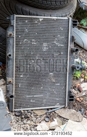 The Damage Of Car Cooling Radiator. The Old Radiator Of The Damaged Car.