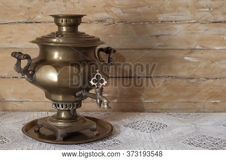 Russian Brass Samovar Antique On A Wooden Table