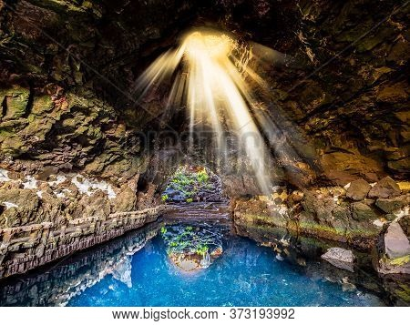 Cave Jameos Del Agua, Natural Cave And Pool Created By The Eruption Of The Monte Corona Volcano In L