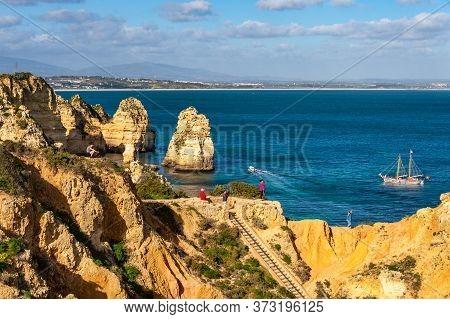 Lagos, Portugal - 5 March 2020: Tourists Visiting Ponta Da Piedade