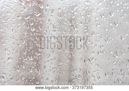 Raindrops On A Window Pane. Cloudy Weather, It Is Raining.