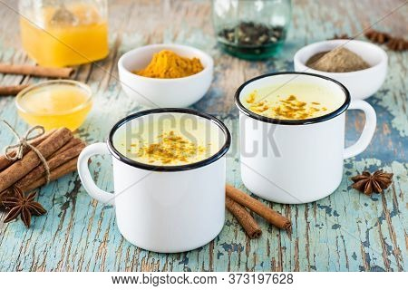 Detox Drink. Golden Milk With Turmeric And Cinnamon In Mugs On A Wooden Table. Rustic Style