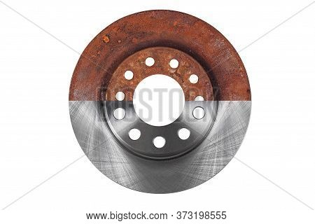 The Brake Disc New And Old Are Combined In One Photograph And Isolated On A White Background