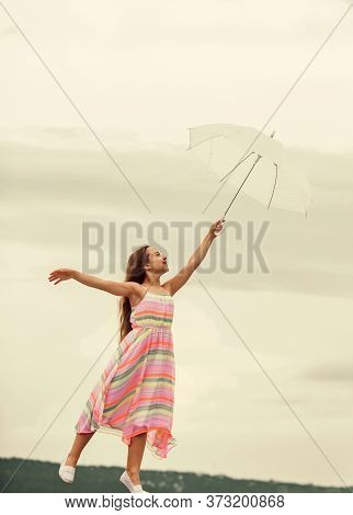Girl With Light Umbrella. Fairy Tale Character. Happy Childhood. Feeling Light. Anti Gravitation. Fl