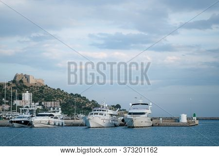 Large Yachts Moored In Port In The Sunny Summer Day On Mountains And Blue Sky Background. Happy Vaca
