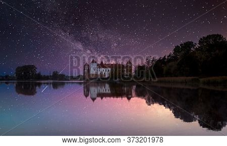 Mir, Belarus.scenic Night View Of Mir Castle Complex In Evening  And Reflexions On Lake Water.