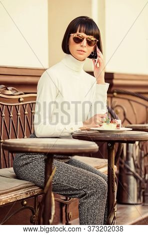 Leisure Concept. Woman Attractive Elegant Brunette Spend Leisure Cafe Terrace Background. Pleasant T