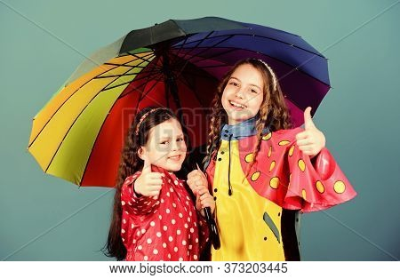 Rainy Weather With Proper Garments. Happy Childhood. Bright Umbrella. It Is Easier To Be Happy Toget
