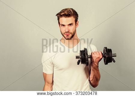 Strong Muscles And Power. Man Lifting Barbell. Sportsman Training In Gym. Sport Dumbbell Equipment.
