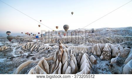 Cappadocia, Turkey - January 6, 2020: Color Balloons In The Sunrise Sky. Cappadocia, Turkey.