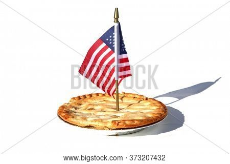 Apple Pie. Fresh Baked Apple Pie. Isolated on white. Lattice top Apple Pie. Whole Fresh Baked Pie in an Aluminum pan and an American Flag. 4th of July Home Baked Fruit Dessert.