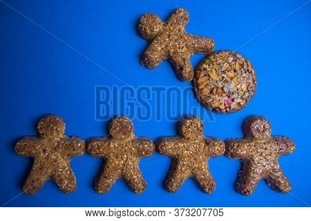 Cookie Figures Of Men On Blue Background. Flat Lay Shot Of Freshly Bakery Gingerbread Cookies Man. S