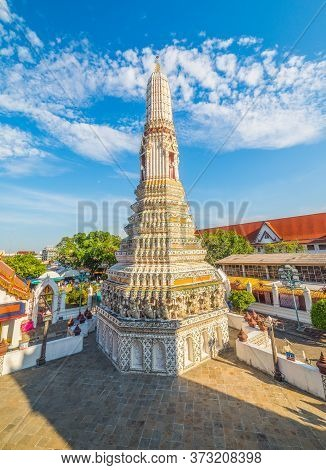 White Ancient Pagoda At Wat Arun (temple Of Dawn) With Blue Sky With Clouds. A Famous Place And Tour