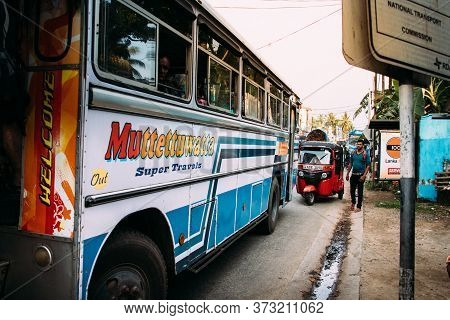 Galle, Sri Lanka - February 17th, 2019: A Public Bus And A Tuk Tuk At Matara Road In Galle, Sri Lank