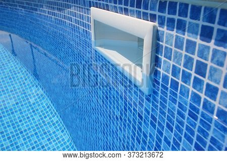 Drain Hole In The Pool With Blue Tile. Pool Filtration System. Clean Water.