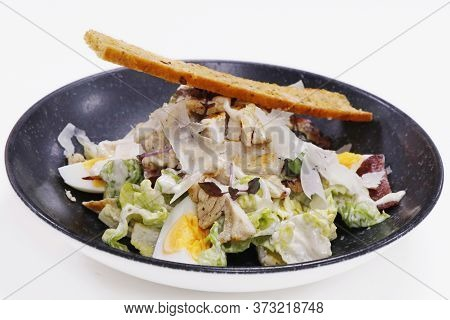 Traditional Caesar Salad Romain Lettuce, Boiled Egg, Anchovy And Bread Cruton
