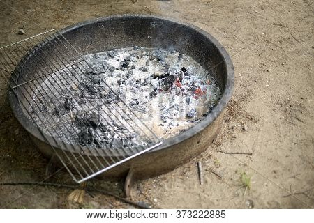 Campfire At A Camping Site With A Grate