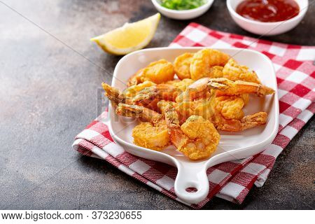 Southern Fried Shrimp On A Platter With Hot Sauce