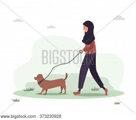 Young Arab Woman In Hijab Walks With Dog Through The Woods. Concept Happy Girl In Yellow Dress With