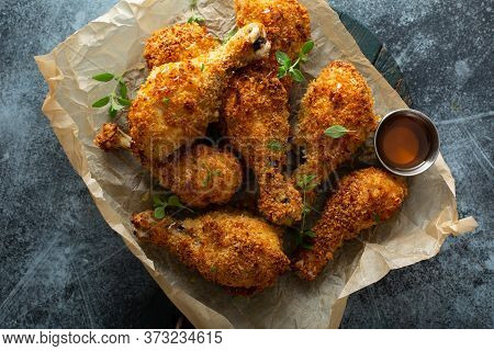 Panko Breaded Fried Chicken Drumsticks With Hot Honey Sauce