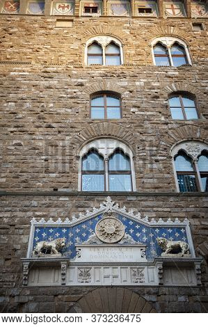 Florence, Italy - October 2019: The Frontispiece Decorated At The Entrance Of Palazzo Vecchio, The T