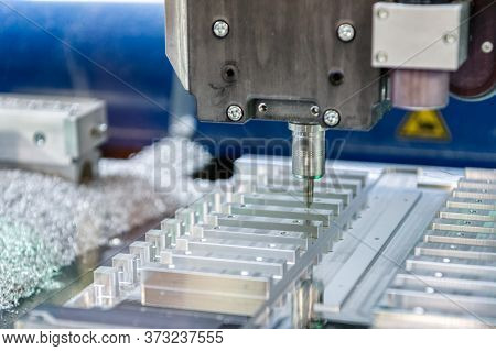 Cnc Milling Machine During Operation. Produced Milling Parts With A Strong Supply Of Cooling Lubrica