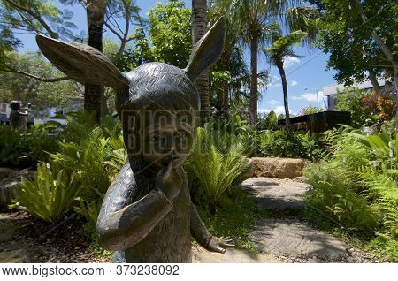 Brisbane, Queensland, Australia - 29th January 2020 : Alice In Wonderland Style Child Statue Located