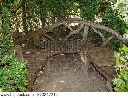 Dordogne, France - September 3, 2018: Wooden Bench In The Gardens Of The Jardins De Marqueyssac In T