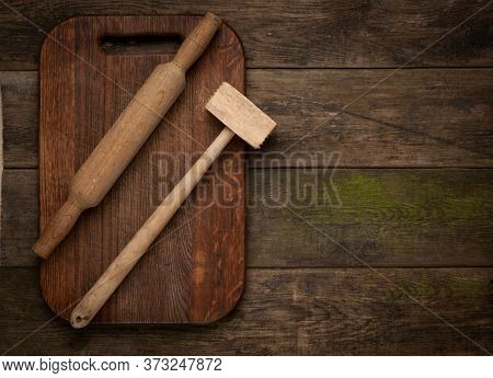 Rural Vintage Wood Kitchen Table With Blank Cook Book And Cooking Tools. Background With Free Recipe