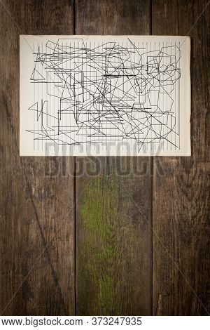 Old Paper Sheet With Abstraction On Wooden Background