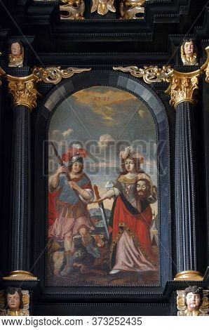 ZAGREB, CROATIA - MAY 16, 2013: St. George and Judith with the head of St. John the Baptist, altar of the Holy Spirit in the Church of Saint Catherine of Alexandria in Zagreb, Croatia