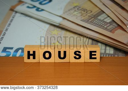 House Message Word On A Wooden Desk On Cube Blocks With Euro Banknote Background
