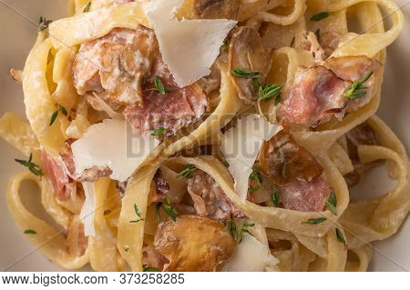 Close Up Food Background Pasta Fettuccine With Mushrooms, Bacon And Parmesan Cheese