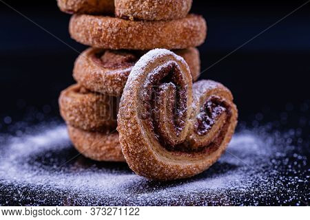 Cookies In The Form Of A Heart With Powdered Sugar.delicious, Fresh Cookies Are Stacked In A Column
