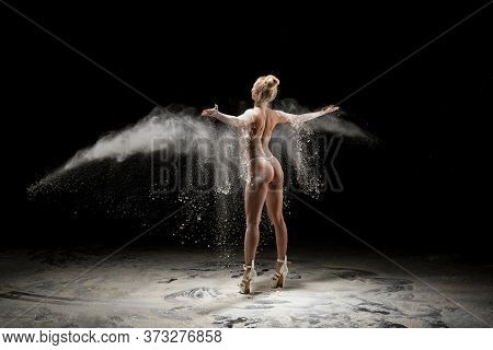 Anonymous Topless Woman Throwing Sand In Air