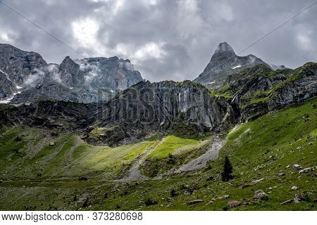 Swiss Mountain Landscape. Alpine Panorama With Mountain Trails For Hiking.