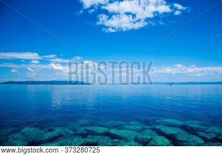 Seascape Of The Dalmatian Coast. Blue Composition Of The Sea And Sky.