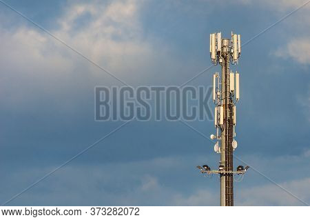 Electromagnetic Radiation. Telecommunication Tower With 5g And 4g Antennas Among Clouds (with Copy S