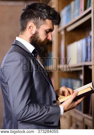 Handsome Well-dressed Man In A Room With Classic Vintage Interior Reading A Book.