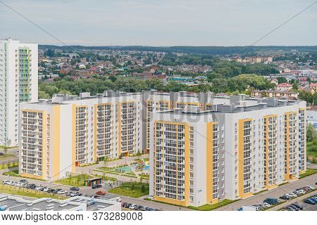 Aerial Panoramic View Dense Of Hdb Apartment Buildings At Midday. High Rises Flat Complex Grass Cour